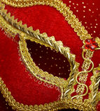 Theatrical mask on red background Royalty Free Stock Photos