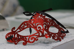 Theatrical mask. Red theatrical mask on the table Stock Photography