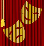 Theatrical masks. Against the background of red theater curtain - theatrical masks Royalty Free Stock Photography