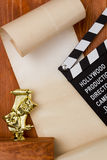 Theatrical masks and movie clapper Royalty Free Stock Photo