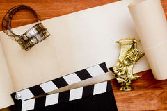 Theatrical masks and movie clapper Stock Photo