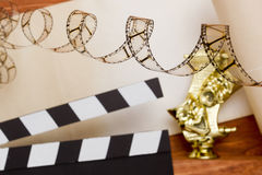 Theatrical masks and movie clapper Stock Photography