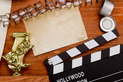 Theatrical masks and movie clapper Royalty Free Stock Image