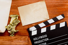 Theatrical masks and movie clapper Royalty Free Stock Photos