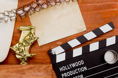 Theatrical masks and movie clapper Stock Image