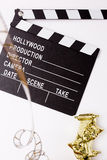 Theatrical masks, party poppers and films for cinema Royalty Free Stock Photo