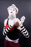 Theatrical mime with dollars in their hands Royalty Free Stock Images