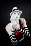 Theatrical mime with dollars in their hands Royalty Free Stock Image