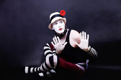 Theatrical mime in white hat Royalty Free Stock Images
