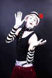 Theatrical mime in white hat with red flower Stock Images