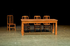 Theatrical properties. The theatrical properties, table and chairs, on stage Stock Photos
