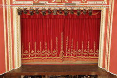Theatrical red curtain Royalty Free Stock Photography