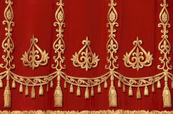 Theatrical red curtain. Theatrical red velvet curtain with gold pattern Royalty Free Stock Photography