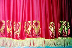 Theatrical red velvet curtain with gold pattern background royalty free stock photo