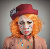 Theatrical sad clown. Theatrical sad and depressed girl clown crying Royalty Free Stock Photos