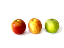 Thee colorful apple Stock Images