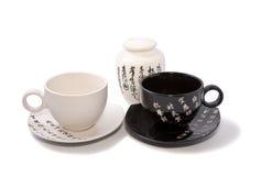 Thee-dingen in Aziatische stijl met hiërogliefen stock foto's