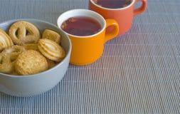 Thee en koekjes Stock Foto's