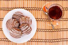 Thee en koekjeskoekjes Stock Fotografie