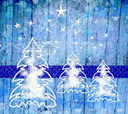 Thee firs with snow. Celestial background with firs and white stars Stock Images