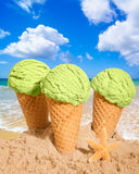 Thee Minty Icecreams. Three mint ice cream cones in the sand at the beach Stock Image