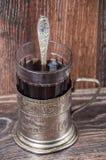 Thee in uitstekend glas met glas-houder Royalty-vrije Stock Afbeeldingen