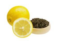 Theebladen en citroen twee Royalty-vrije Stock Afbeelding