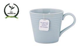 Theekop, geëtiketteerd theezakje met een eco vriendschappelijk die etiket op w wordt geïsoleerd Stock Foto's