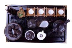 Theepot op een bruine houten oppervlakte. Royalty-vrije Stock Afbeeldingen