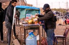 Theeverkoper in Irak Stock Foto