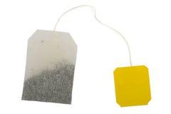 Theezakje, geel etiket stock afbeelding