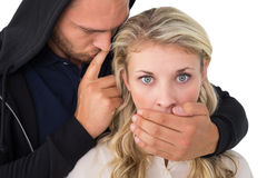 Theft covering young womans mouth Stock Photography