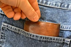 Theft of a purse. From a pair of jeans stock images