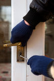 Theif breaking-in burglary security Stock Image