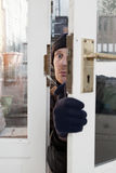Theif breaking-in burglary security Stock Photos
