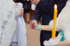 Their hands in a towel in the church Royalty Free Stock Images