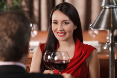 Their special date. Beautiful mature couple drinking wine at res Stock Photo