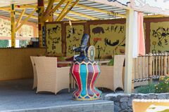 Thematic cafe exterior with Africa tribal pictures and statues