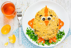 Thematic Easter snack shaped funny chick. Easter cute salad. Creative food art idea on Easter meal party for children. Thematic Easter snack shaped funny chick Royalty Free Stock Images