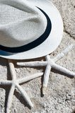 The theme of the beach, recreation, vacation. Straw hat, glasses. And starfish Stock Photo