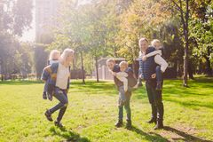 Theme family active leisure outside in nature. large Caucasian family with four children. Mom and Dad actively relaxing. enjoy royalty free stock photo