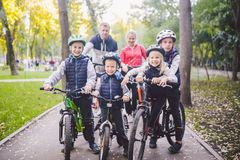 Theme family sports vacation in park in nature. big friendly Caucasian family of six people mountain bike riding in. Forest. Children brothers and sister stand stock photography