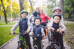 Theme family sports vacation in park in nature. big friendly Caucasian family of six people mountain bike riding in. Forest. Children brothers and sister stand stock photo