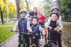 Theme family sports vacation in park in nature. big friendly Caucasian family of six people mountain bike riding in. Forest. Children brothers and sister stand stock image
