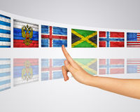 Theme flags. Finger presses one of virtual screens. Mirror reflection Royalty Free Stock Image