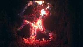 The theme flame. Video of fire brown wood dark grey black coals on bright yellow fire inside metal brazier. Wood burning in the braziers stock video footage
