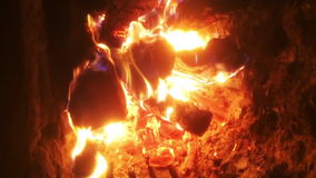 The theme flame. Video of fire brown wood dark grey black coals on bright yellow fire inside metal brazier. Wood burning in the braziers stock footage
