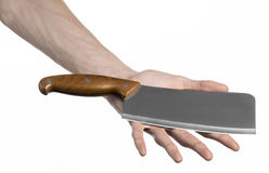 The theme of the kitchen: Chef hand holding a large kitchen knife for cutting meat on a white background isolated Stock Photos