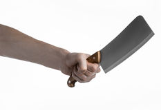 The theme of the kitchen: Chef hand holding a large kitchen knife for cutting meat on a white background isolated Royalty Free Stock Photo