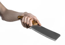 The theme of the kitchen: Chef hand holding a large kitchen knife for cutting meat on a white background isolated Stock Photo